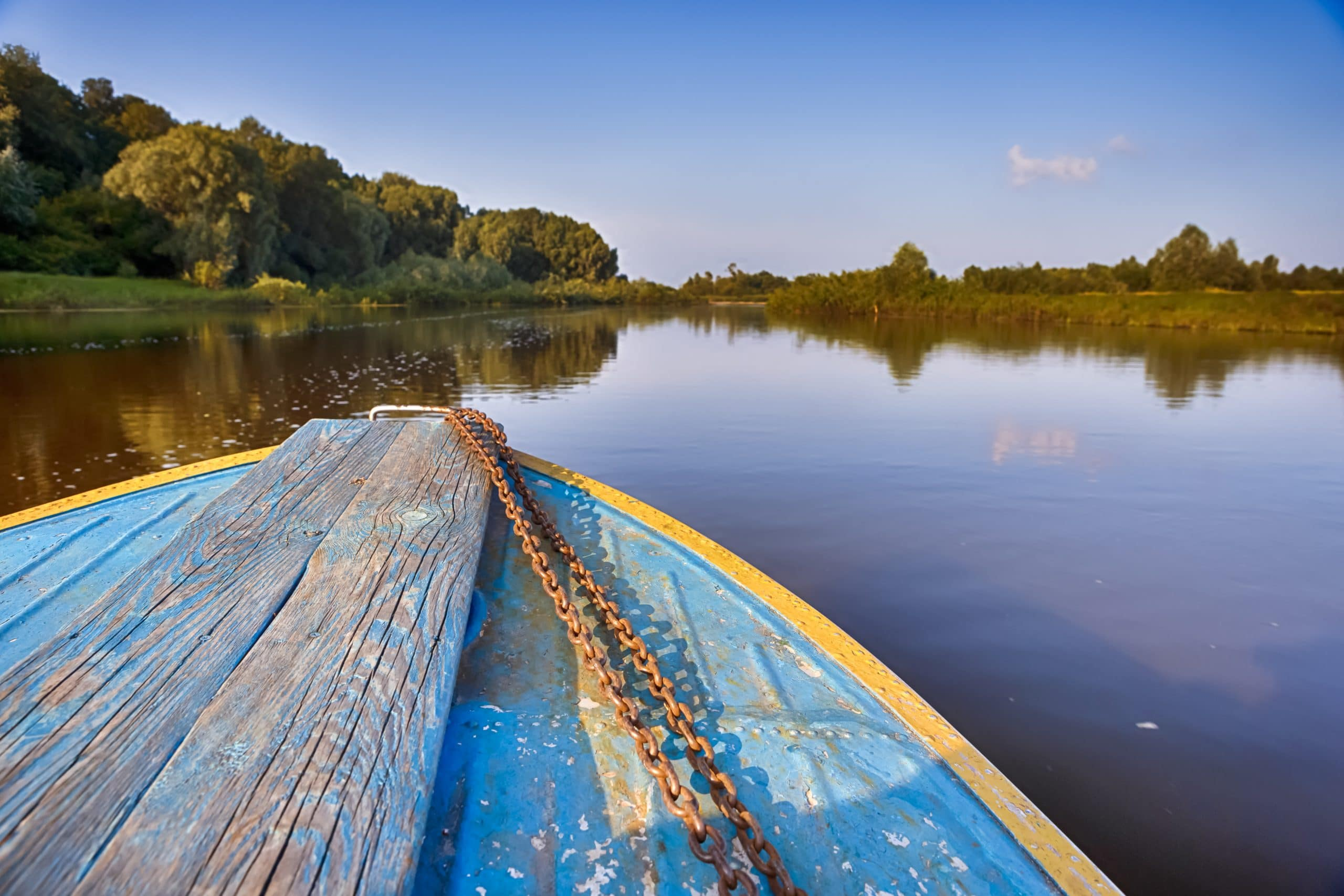 Belarussian Destinations. The Pripyat River with Motorboat Passing Along the Shore. Horizontal Shoot