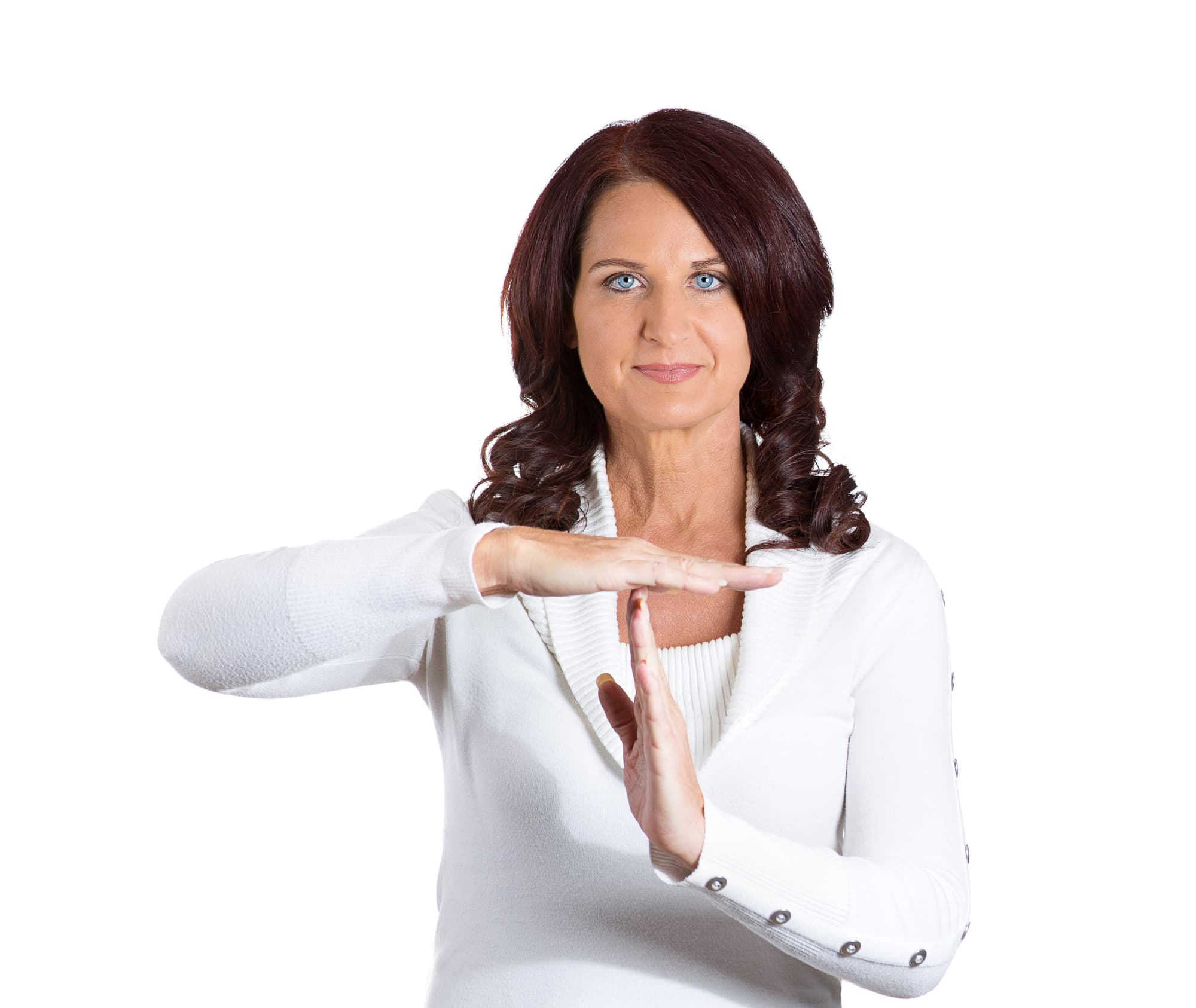 Closeup portrait middle aged happy, smiling woman showing time out gesture with hands, isolated white background. Positive human emotions, facial expression feelings, body language, reaction, attitude